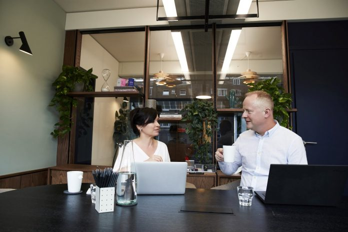 Man and Woman Having a Meeting in the Office